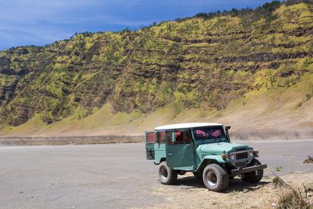 tengger: Tourists Jeep rent pass Savanna at Mount Bromo volcanoes in Bromo Tengger Semeru  National Park, East Java, Indonesia. Stock Photo