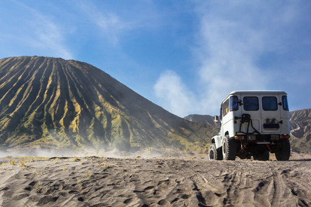 4x4 car service for tourist on desert at Bromo Mountain, Mount Bromo is one of the most  visited tourist attractions in Java, Indonesia Stock Photo