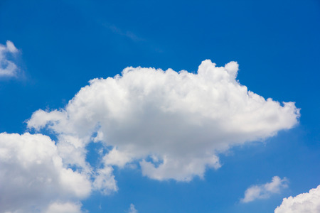 tranquil atmosphere: blue sky and small cloud background Stock Photo