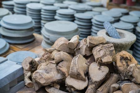 thanaka: Heap of Kyauk pyin stone slab and Rhanaka wood for traditional cosmetic for using with Thanaka,  popular for Burmese people Stock Photo