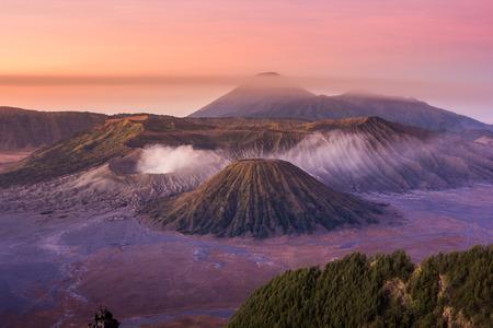 Mount Bromo twilight sky sunrise time with fog nature landscape background, Java,  Indonesia Stock Photo