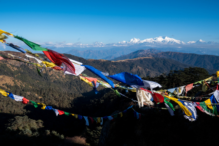 Tibetan prayer flag or Lung ta and Kangchenjunga high mountain range view from the Sandakphu , Darjeeling,  India