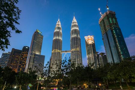 Kuala Lumpur, Malaysia - January 8:The Petronas twin towers  at night with fountain show in front of the Kuala Lumpur City Center  (KLCC) on January 8, 2017 in Kuala Lumpur, Malaysia.