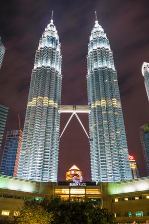 Kuala Lumpur, Malaysia - January 7:The Petronas twin towers  at night with fountain show in front of the Kuala Lumpur City Center  (KLCC) on January 7, 2017 in Kuala Lumpur, Malaysia.