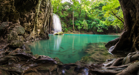 Waterfall in Thailand name Erawan, forest environment with big tree  and emerald water at Kanchanaburi provience