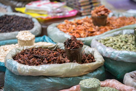 Various of Indian colored powder spices and dry ingredient food on the market in India Stock Photo