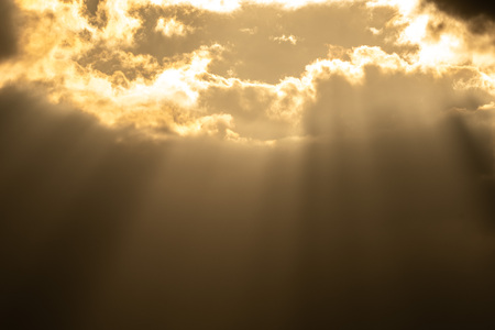 Sunray thought cloud from above show background dramatic from sunset