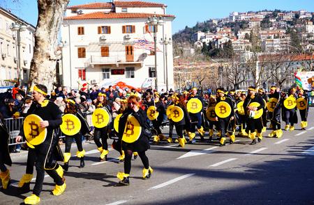 Fiume, Croatia, February 11, 2018. Group young people masking in bitcoin on carnival in Fiume, Croatia Editorial