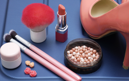 Women accessories, brushes and lipstick, flat lay. Fashion and female beauty concept on abstract blue color Stock fotó