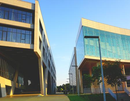 Osijek, Croatia, August 7, 2018. Pass between two modern faculty buildings on university campus in Croatian town Osijek in Slavonia region
