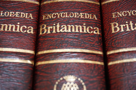 Rijeka, Croatia, September 25, 2018. Top view of volume encyclopedia Britannica with title, close up view of red and gold cover Sajtókép