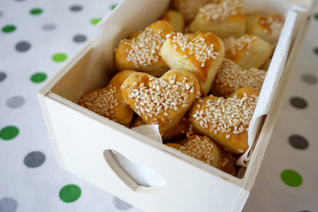 Snack salty cookies in shape of heart with organic sesame in the decorative wooden box