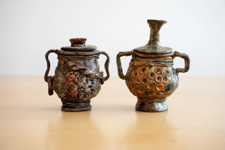 Two artwork made of ceramic pots like ancient