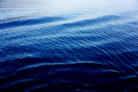Gradient dark blue color tone background in big dimension. Sea surface with dynamic waves
