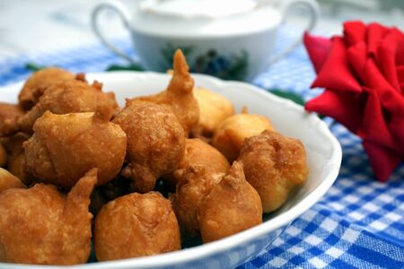 Just fried homemade fritters, dumplings made of dough with flour and spices and fried in oil Stock Photo