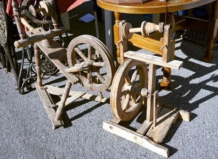 Two wooden spinning wheels for sale on the street fair Stock Photo