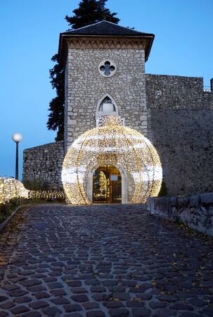Entrance to the Trsat Castle in the Croatian city of Rijeka through the biggest Advent ball