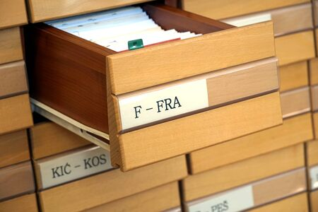 Vintage wooden library catalog with drawer opened on letter F