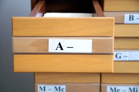 Letter A on an open wooden drawer of a library catalog, close up