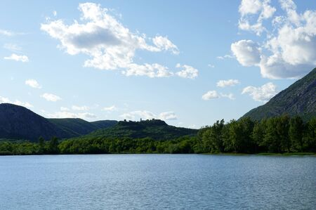 Beautiful nature and shore of Lake Tribalj below the old town of Drivenik in Croatia Standard-Bild