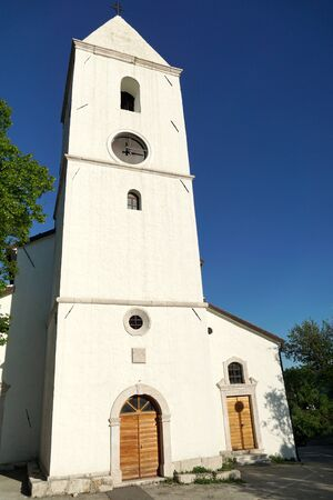 Old restored baroque church with a bell tower in the Drivenik, Croatia
