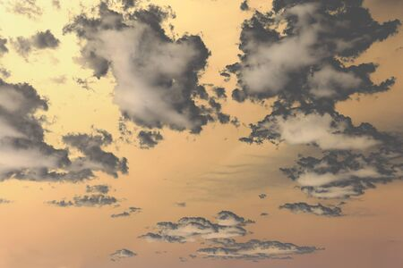 Abstract nature background with dramatic clouds on peachy color sky Standard-Bild