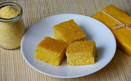 Homemade corn cake on the white plate. Three appetizing pieces of healthy snack