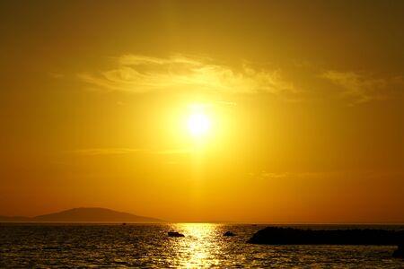 Beautiful orange color tone sunset on the sea horizon