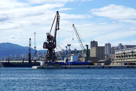 Rijeka, Croatia, July 3rd, 2020. Big iron harbor cranes in Croatian town of Rijeka