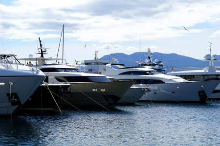 Rijeka, Croatia, July 3rd, 2020. Big classy yachts anchored in a line in the harbor