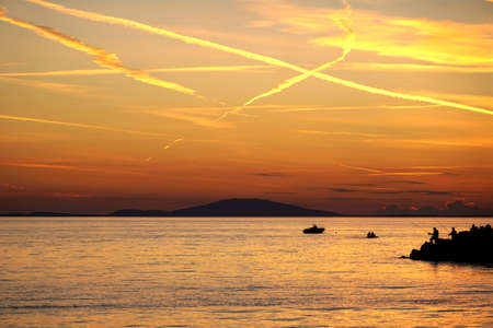 Burning orange dramatic sky above the seascape at sunset in orange color tone Standard-Bild