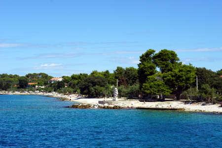 Silba, Croatia, 16th August, 2020. People walking on the stone mole in the Croatian town Silba on Silba island Editorial