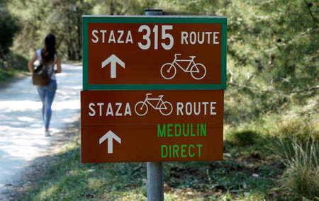 Marking of the cycling route in the green wild forest in the Kamenjak Nature Park in Croatian Istria