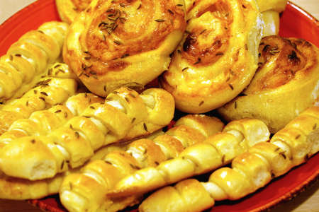 Fresh homemade bread dough pastries with cumin seeds