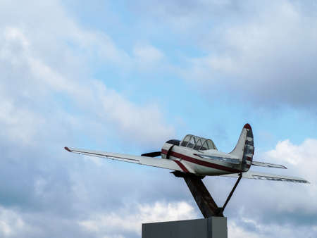 Monument to soviet sports and training aircraft - Yak-52 aircraft plane in Park Tanai in Novosibirsk, Russia.