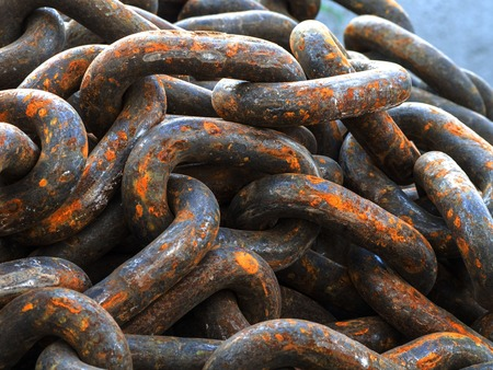 Rusty old chain ropes - the big rusty chains Stock Photo