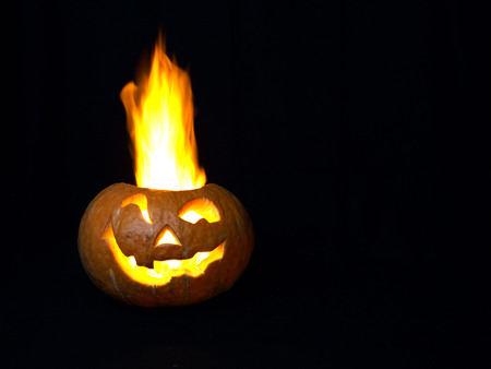 hole: Scary head made of pumpkin. A real fire. Holiday Halloween.