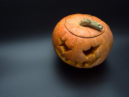 frightful: Scary head made of pumpkin. Holiday Halloween. Stock Photo