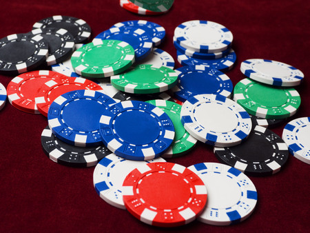 Casino poker money chips texture. Stack of poker chips as background. Stock Photo