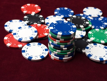 Casino poker money chips texture. Stack of poker chips as background. Stockfoto