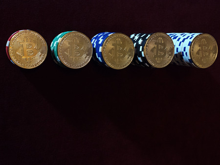 Bitcoin coins on poker chips. The ladder of financial growth.