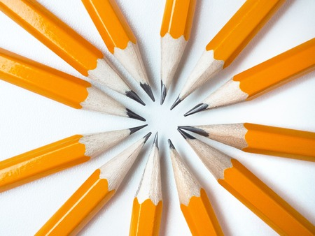 Yellow pencils on a white background. Around the fictional center point. 写真素材