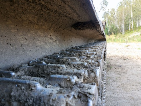 Caterpillar of military tank or excavator. Close-up photo.