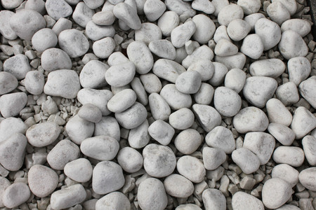 White pebble stone texture on the ground. Simplicity, stones. 스톡 콘텐츠