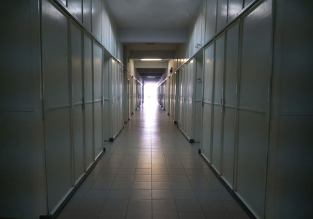 Detail of a white corridor in a hospital. Ray of light at the end of the tunnel.