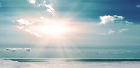 Winter season at coast frozen river or sea. Bright sun rays heat the ice. Banco de Imagens