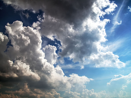 Blue sky with clouds and sun rays. Different depth of color and shadow.