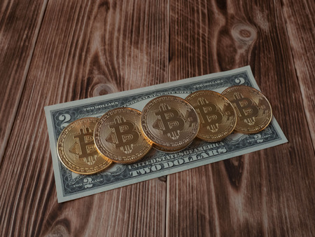 Physical version of Bitcoin and banknotes of two dollar. Exchange bitcoin for a dollar. Conceptual image for worldwide cryptocurrency and digital payment system.