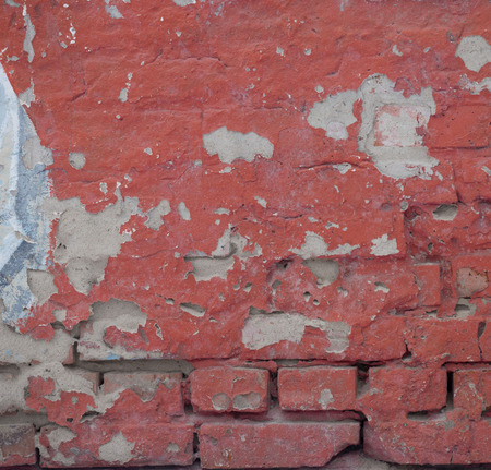 Empty Old Brick Wall Texture. Painted Distressed Wall Surface. Grungy Wide Brickwall. Grunge Red Stonewall Background. Shabby Building Facade With Damaged Plaster. Copy Space. Banco de Imagens