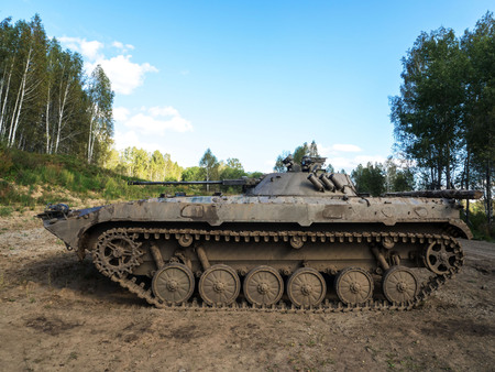 Military tank under the sky in the forest zone. Banco de Imagens - 115273505